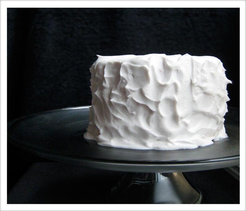 Lemon Olive Oil Layer Cake with Coconut Whipped Cream Frosting